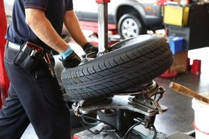 Photo Of Framingham, MA Technician Working On Tires - Snow's Garage